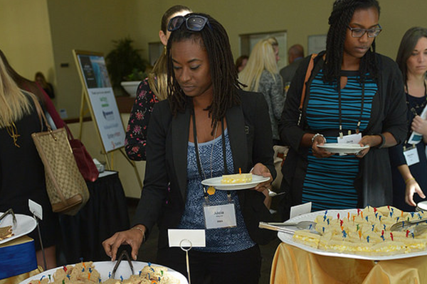 Attendees enjoying breakfast hosted by Auction.com